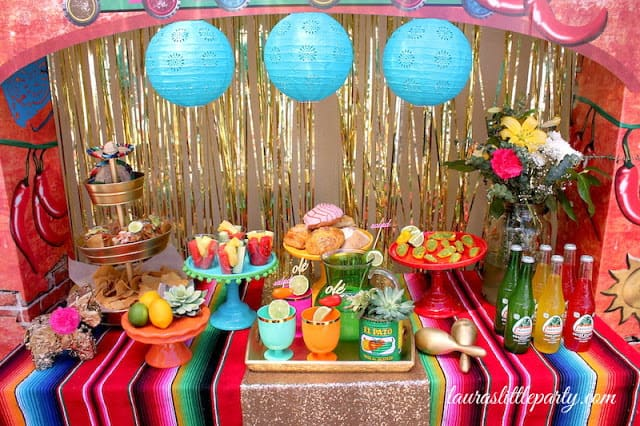 A bright and colorful fiesta birthday party theme is a fun and affordable choice!