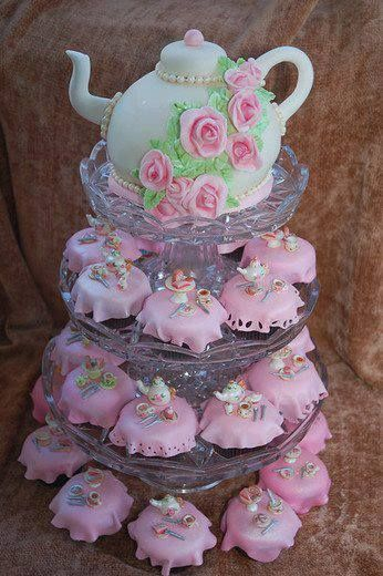 Tea pot cake with decorated cupcakes