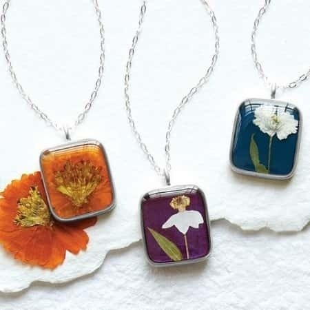 Treat a special lady to a beautiful necklace that features a real dried flower from her birth month.