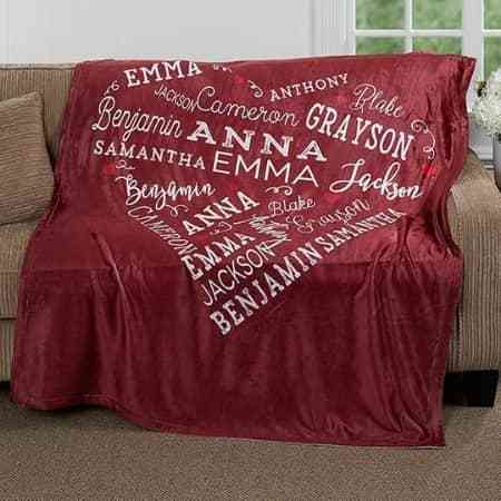 Delight Mom with this beautiful personalized blanket that features her loved one's names printed in a heart shape.