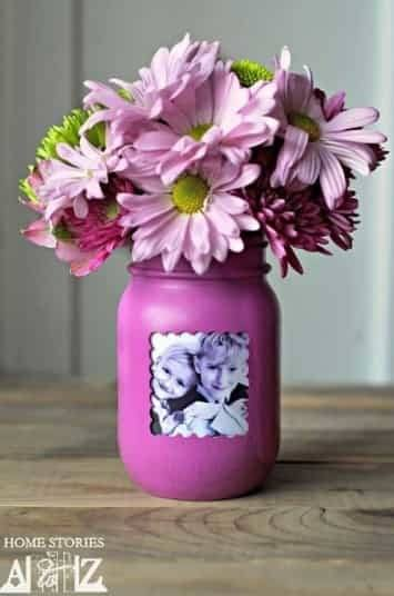 Mason jar photo centerpiece is such a cute way to display pictures at a birthday party!