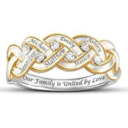 Elegant diamond ring for Mom features her kids names and the sweet inscription Our Family Is United by Love.